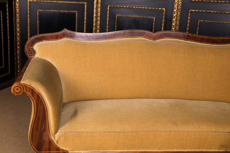 Mahogany on solid conifers with maple thread inserts. Decorative curving frame, on volute-shaped legs. Highly declining armrests. Wide backrest with a beautiful frame. The seat and backrest are covered with a high-quality Classic upholstery.  A good