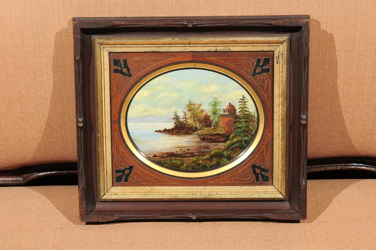 The 19th century oval oil on canvas painting of Hudson River & Washington's Tomb in mahogany wood matting with gilt and ebonized accents. The frame consist of giltwood and mahogany.