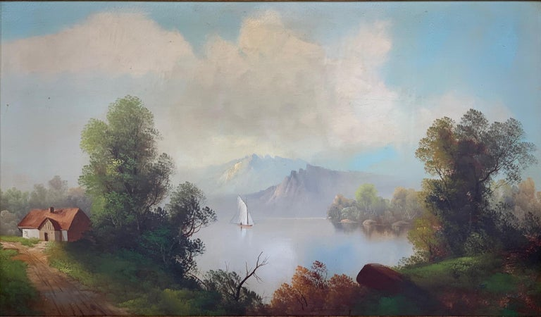 19th century oversized oil on canvas landscape depicting a home in the forest with a mountain range and a body of water with a boat. Mounted on a wood and gild frame done in American Romanticism. Measurements of the Canvas: H: 28 in x W: 46.5 in.