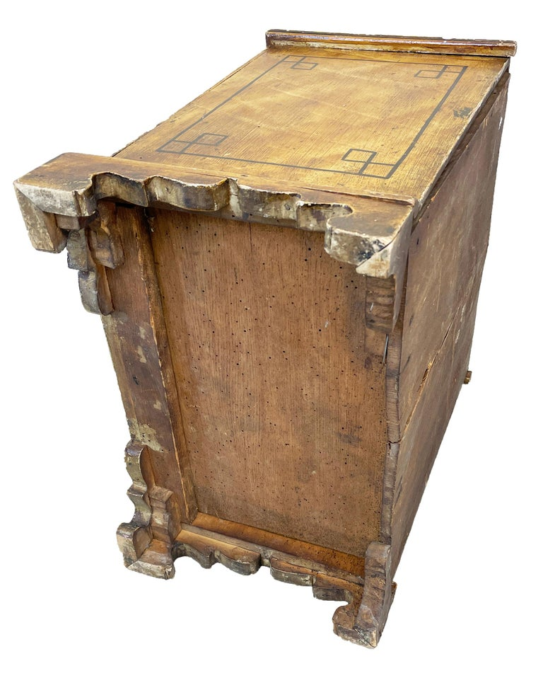 A very attractive mid-19th century painted pine miniature chest of two short and two long drawers having original brass knob handles raised on original shaped bracket feet  (There is often debate as to the original purpose regarding many items
