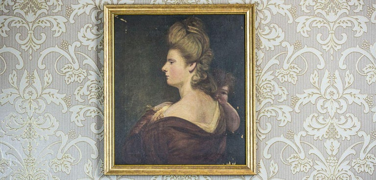 We present you this oil on canvas, circa the early 19th century, with a portrait of a lady, in profile, holding a baby on her arm. The condition of this piece of art is good. However, there are chips of the paint in some places, and the surface of