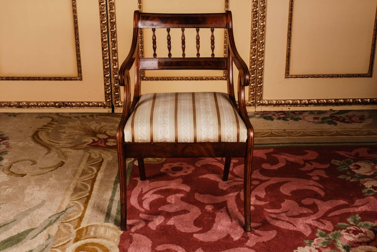 Solid mahogany with maple inserts. Trapezoidal frame on saber-shaped legs. Strongly curved supports, ending in rolled volutes for slightly rising armrests. High-profile, shaped backrest frame with a wide finish.  (B-114).