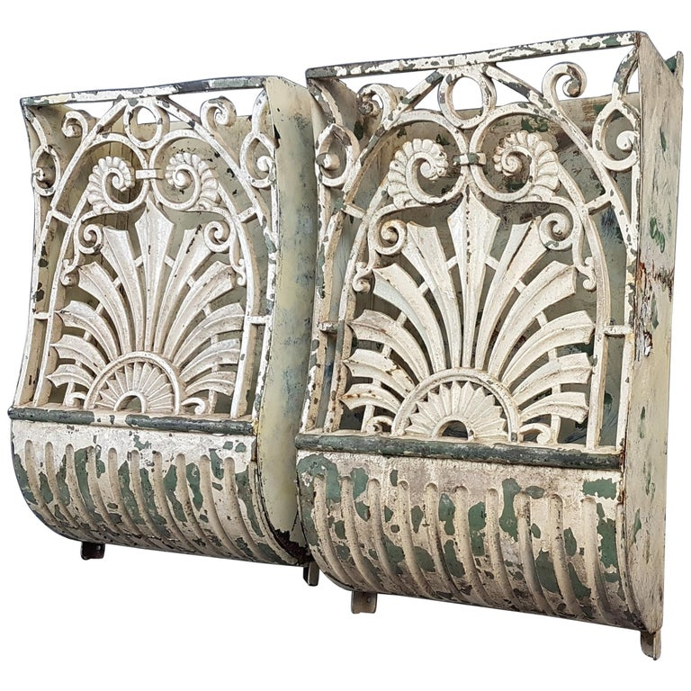 19th Century Pair of Cast Iron Wall Mounts in Original Paint For Sale