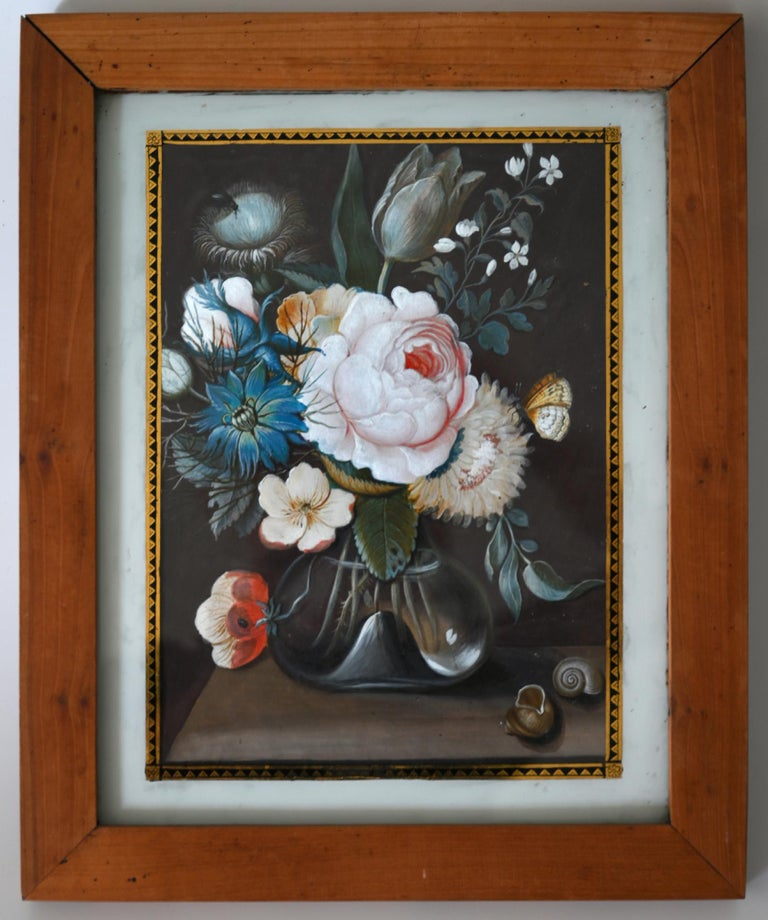The pair of flower still lifes are probably made in Augsburg (South Germany). They are made with an technic which is called gouache. The frame is original and is made out of cherrywood. The gouache paintings are framed with reversed glass