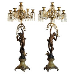 19th Century Pair of French Figurines Patinated and Doré Bronze Candelabra