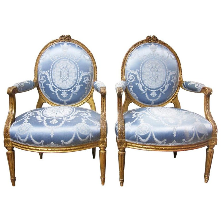 19th Century Pair of French Louis XVI Style Armchairs with a Gold Leaf Finish For Sale