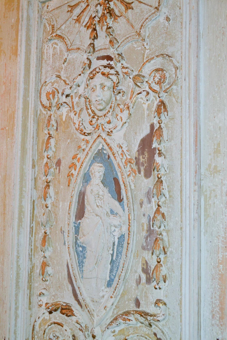 Gorgeous pair of 19th century French carved and painted neoclassical panels.