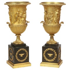 19th Century Pair of Gilt Bronze and Black Onyx Neoclassical Urns