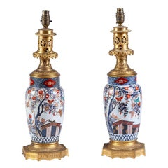 19th Century Pair of Japanese Imari Ware Porcelain Vases with Bronze Fittings