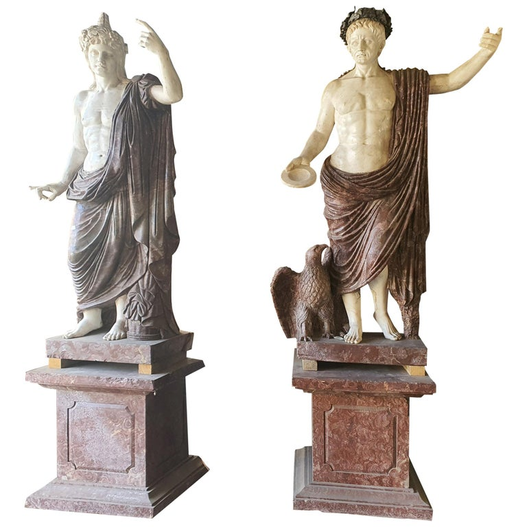 Pair of finely carved marble sculptures depicting Roman emperors. Composed in white statuary marble and red marble.