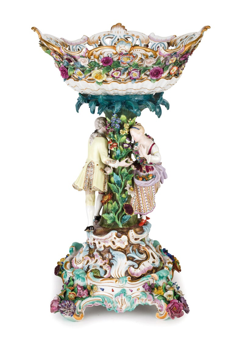 19th century pair of Meissen Porcelain centerpieces. Signed Meissen manufactory.  The pair of centerpiece was made in Germany in the 19th century in finely painted Meissen Porcelain. The centerpieces are composed of a raised one with rich floral