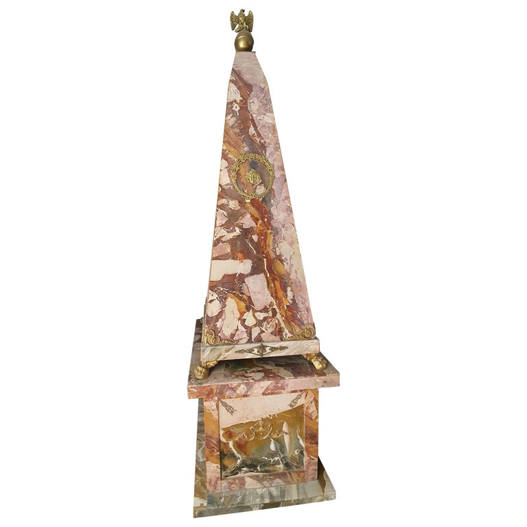 Rare pair of large obelisks entirely veneered in Sicilian open scrub jasper. Gilt bronze applications adorn the all-round obelisks. In the upper part two eagles in gilded bronze dominate.