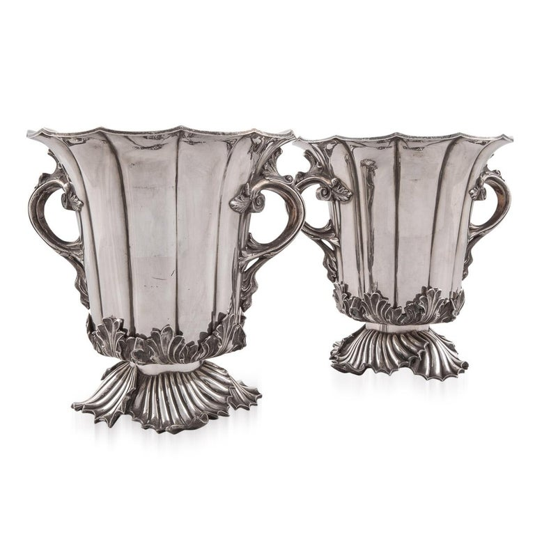 Antique 19th century beautiful and very rare pair of Old Sheffield plate wine coolers by Smith Sissons & Co. Old Sheffield Plate is the process of fusing a layer of silver on to a layer of copper. The process was discovered by Thomas Boulsover in