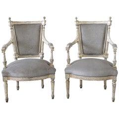 19th Century Pair of Painted and Upholstered Louis XVI Style Open Arm Fauteuils