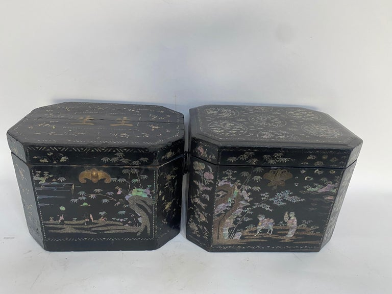 19th century pair of shell Inlaid black lacquer big Chinese storage boxes with bail handles two sides, each with hinged lid reversing to a mother of pearl inlaid decoration, each tea caddies 14.5