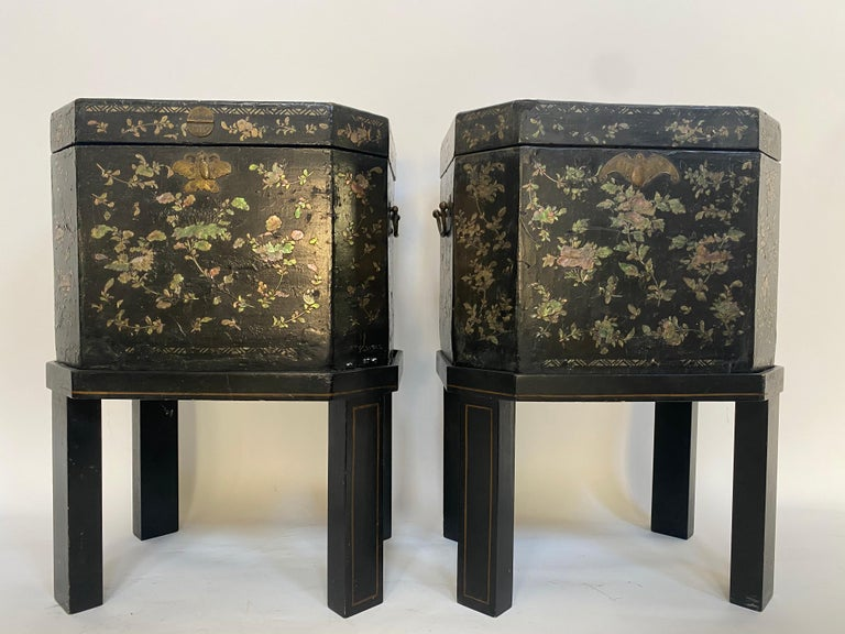 19th century unique pair of shell Inlaid black lacquer big Chinese tea caddies with Bail handles two sides ,each with hinged lid reversing to a mother-of-pearl inlaid decoration and enclosing a fitted pewter canister with double lid, set on a stand,