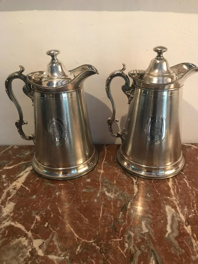 A wonderful pair of silver plate water jugs/ pitchers by Carringtons of Regent Street London. Showing delicate, detailed engraving.