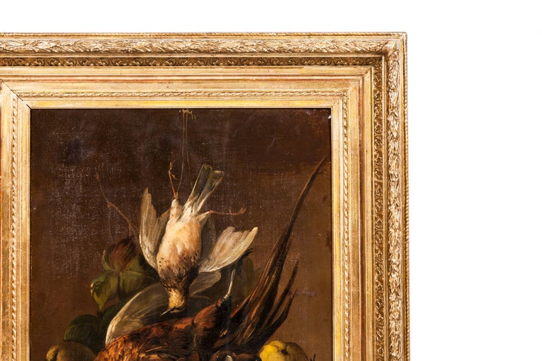 Pair of still lifes paintings with a composition of fruit and winged animals. Beautiful canvases of the French artist Dubois, active in the 19th century in France. The two paintings have the original gilded frames. They underwent minor