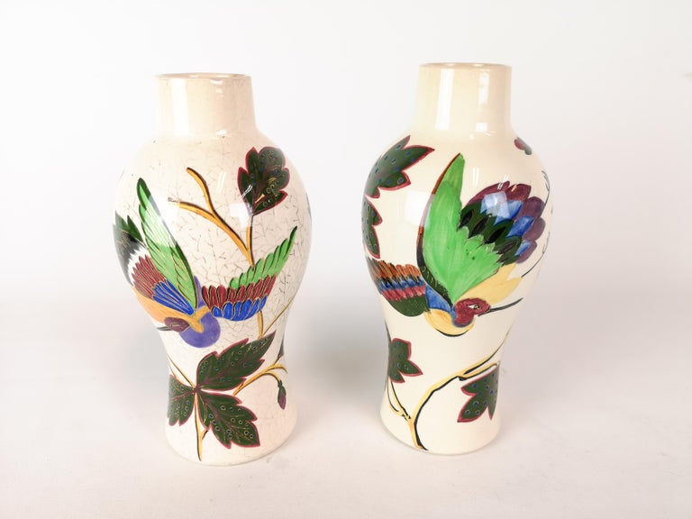 Wonderful pair of Art Nouveau vases. Manufactured at Gustavsberg Porcelain Factory in 1887 Sweden.  The both shows signs of the typical Art Nouveau expressions in flowers and birds.   They both have wear consistent with age and use. But in good