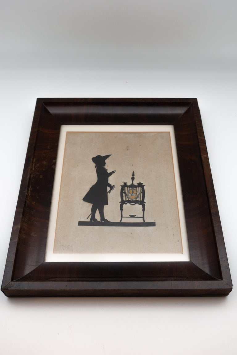 Wood 19th Century Paper Cut Silhouette of Gentleman in Front of a Table For Sale