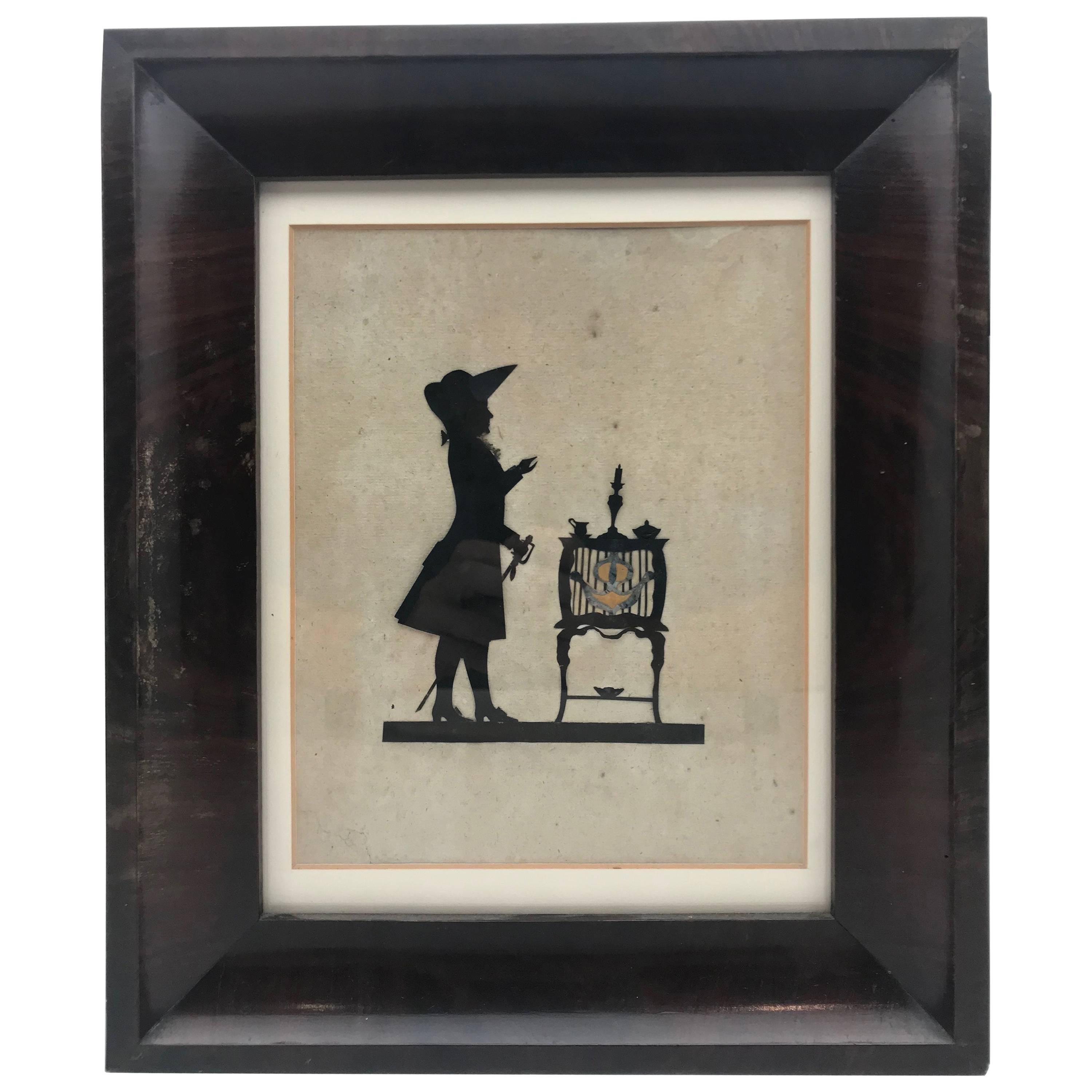 19th Century Paper Cut Silhouette of Gentleman in Front of a Table