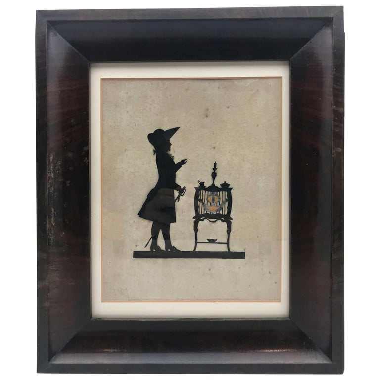 19th Century Paper Cut Silhouette of Gentleman in Front of a Table For Sale
