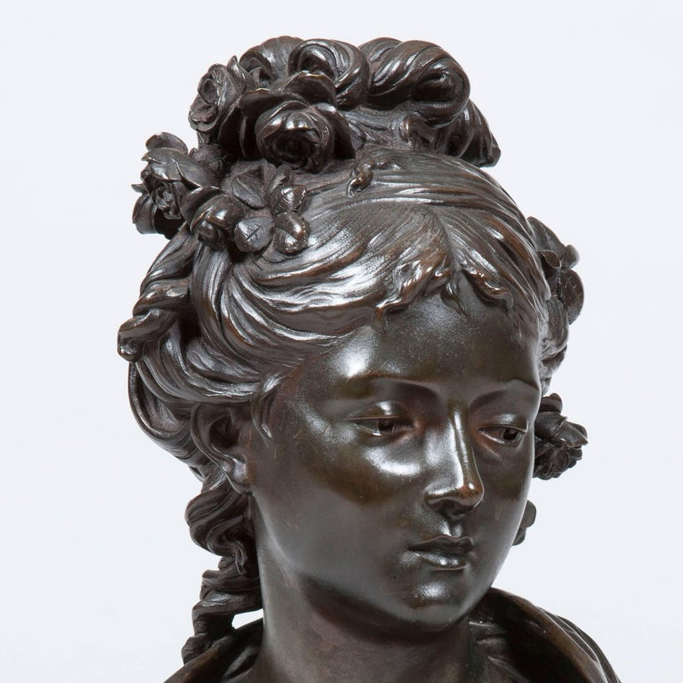 A patinated bronze bust of a Maiden