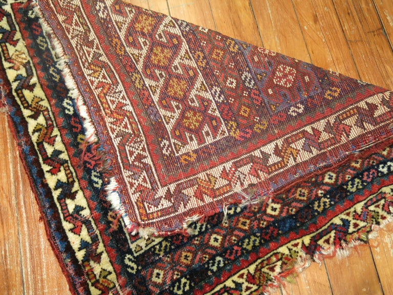 A 19th century authentic handwoven Persian tribal bagface textile rug.