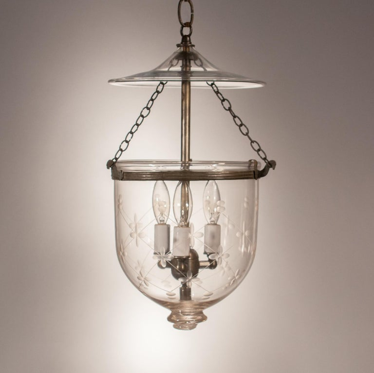 Every bell jar lantern has its own distinct character. This charming, circa 1870 pendant is no exception. Manufactured by S&C Bishop of England, the lantern has the Bishop mark on its pontil. It also features its original smoke bell and rolled brass