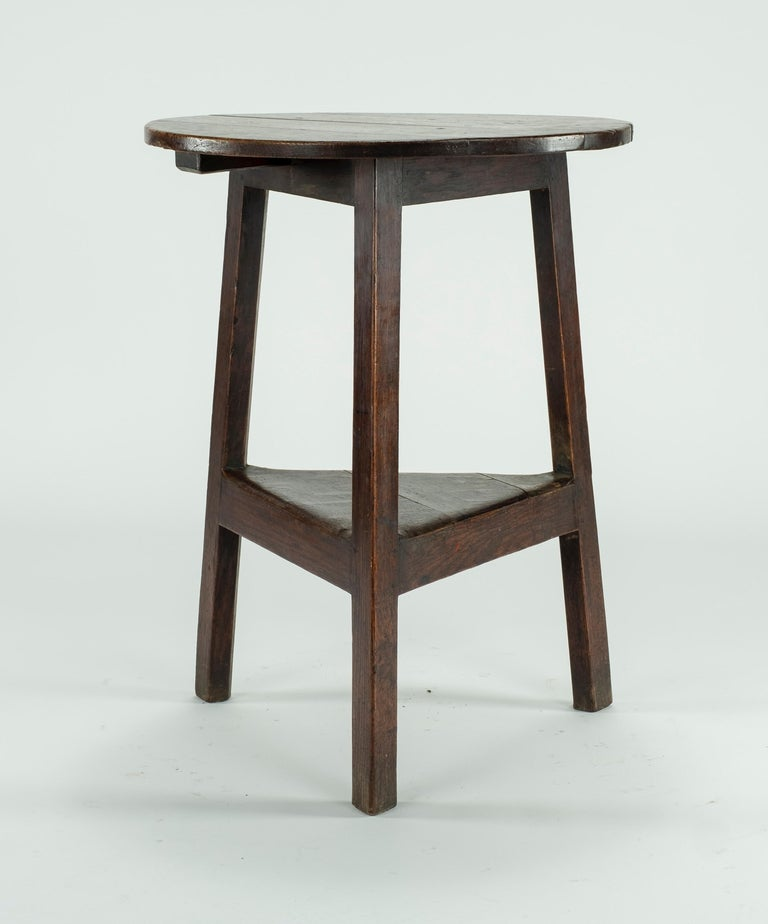 19th century pine cricket tablewith shelf underneath.
