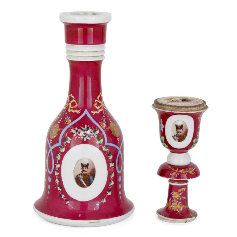 This beautiful porcelain huqqa (or hookah) is of Continental, possibly Russian, origin and was created in the late 19th Century. The item is finely painted and decorated with photo-realistic portraits of the Qajar kings of Persia, Naser al-Din Shah