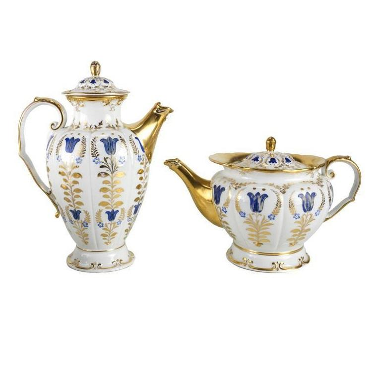 A fine mid-19th century porcelain tea and coffee service by Königliche Porzellan Manufaktur more commonly referred to as KPM. The matching service consists of a coffee pot, tea pot, open creamer, covered sugar and six cup and saucers. Each piece