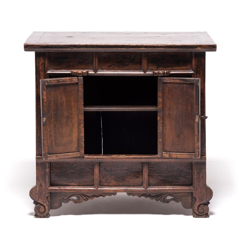 This Provincial two-door cabinet from China's northwest Gansu province is typical of the area's cabinet design during the late 19th century but the paneled front and overall form references styles from the Song dynasty thousands of years earlier.