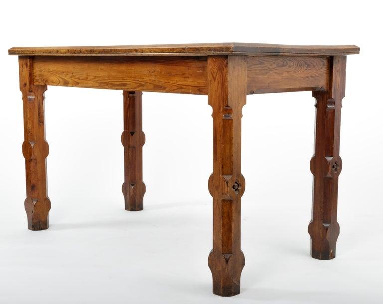 Pugin style English pine table, England, 19th century.