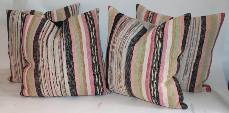 Each pillow measures 22 x 22 and are in pristine condition. The backings are in cotton linen fabric. The inserts are down and feather fill. Can be sold individually @ $395.00 each.