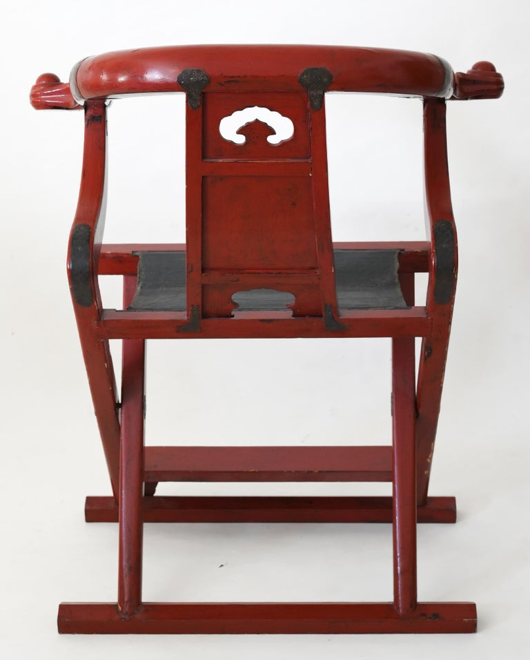 The Chinese folding chair was made in the beginning of the 19th century. It is worked out very beautiful and the red lacquer is in a good condition. The form of the chair is very Classic for the classical Chinese.
