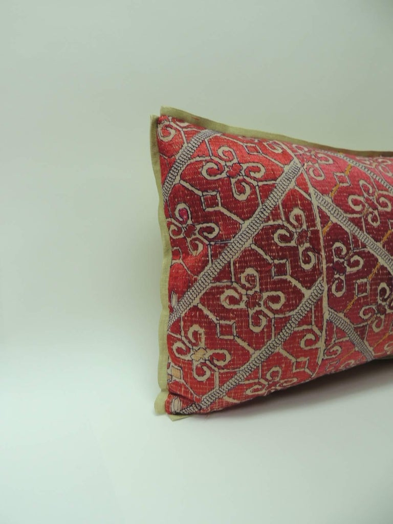 Large 19th century Moroccan embroidered bolster pillows with traditional floral design, floss silk threads in shades of red and green in a chevron pattern. Golden silk  backing same as custom ATG silk golden flat trim.  Decorative pillows hand-made