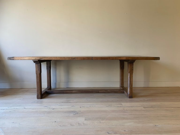 A great 19th century French Farmhouse table. The 2 plank top in beautifully grained elm and the base in oak. Lovely patina, proportions and perfect dimensions. Position Base 42 cm  (16,53