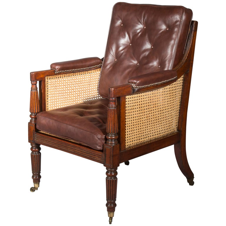 A superb early Regency period library bergère armchair in mahogany,attributed to Gillows of Lancaster and London.  English, circa 1810  This Fine and traditional model of the generously proportioned Classic Gillow bergère features the straight