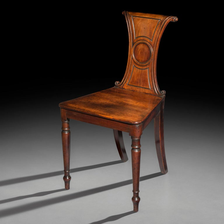 An unusualEnglish earlyRegency period hall chair, in the manner ofGillows of Lancaster and London, circa 1800.  Why we like it Georgian hall chairs in such original condition are rare survivors due to their delicate construction, originally