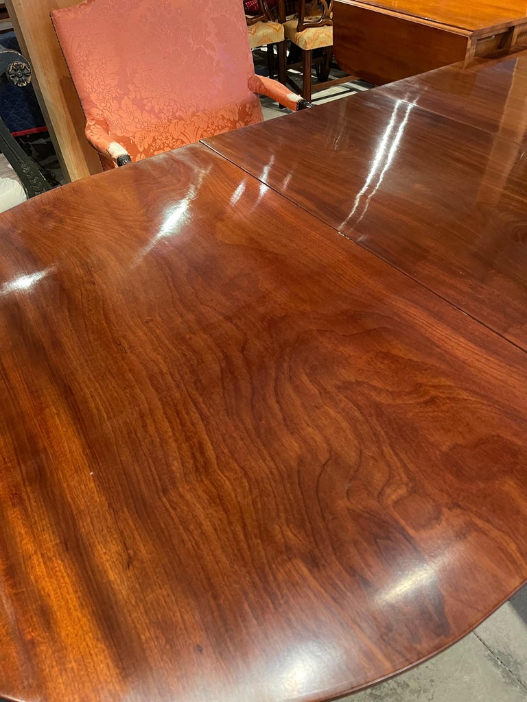 Early 19th century Regency Mahogany four pedestal dining table. Solid MahoganyBoards with well-figured early grain from old growth trees. Large board tops. Leaves original to table.   --Photographs show table in full length and without