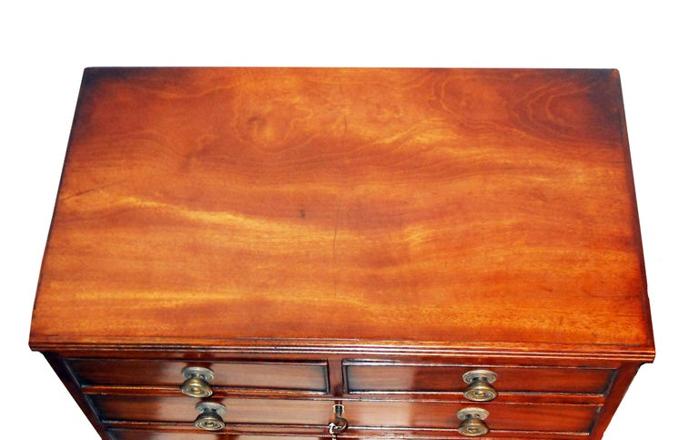 A delightful regency period mahogany miniature chest having two short and three long drawers standing on original splay feet  (There is often a debate over whether miniature furniture was made  as an apprentice piece, which is where somebody
