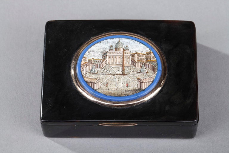 Small rectangular Restauration snuff box crafted in tortoise and gold. The hinged lid is decorated with an oval micromosaic representing St. Peter's Square in Rome. Micromosaic and tortoise are set in a gold setting.  Gold marks: Large guarantee
