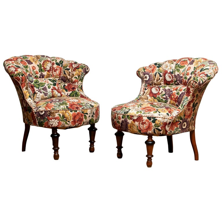 Beautiful and completely restored set of two, French Napoleon III slipper chairs from the 19th century, covered with floral printed fabric. New fabric, bindings, springs. The overall condition of these two chairs is very good!