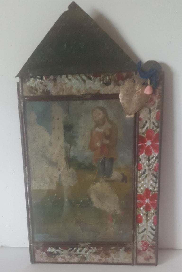 19th Century Retablo, St. Isidro Painted on Tin, in Original Embossed Tin Frame In Distressed Condition For Sale In Van Nuys, CA