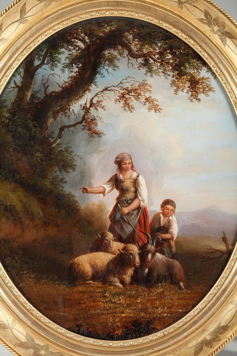 Antique oval reverse glass painting featuring a shepherd and a shepherdess with their sheep, in a landscape. The details are extremely precise. Original giltwood frame decorated with floral motives. Signed Xerey.
