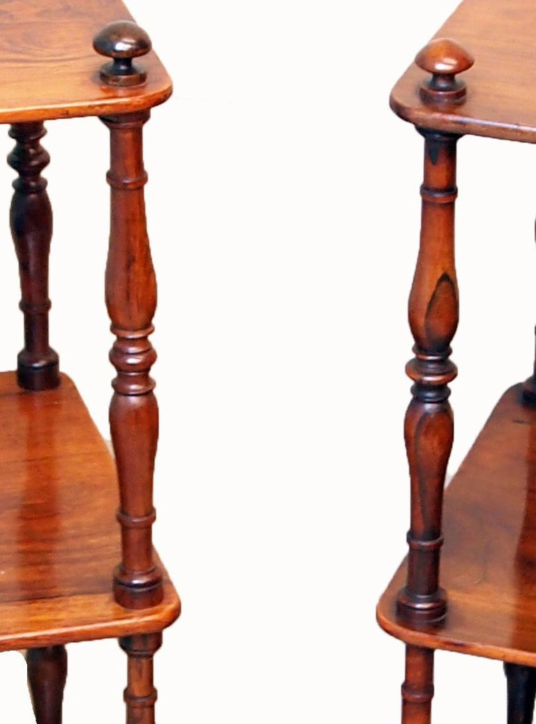 A delightful and good quality mid-19th century matched pair of Rosewood whatnots, or étagère, having three well figured tiers United by turned upright supports terminating on original brass Castors  (An elegant and good quality matched pair of