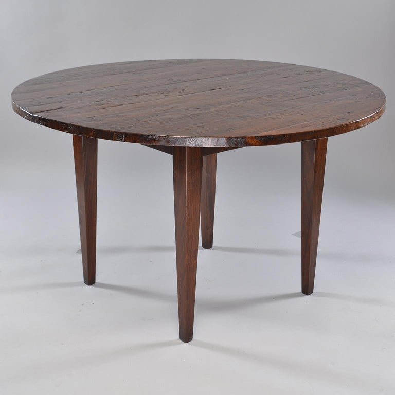 Found in England, this round chestnut table top dates from 1880s. Mounted on a new base, this handsome table is perfect for use as a breakfast or smaller dining table.