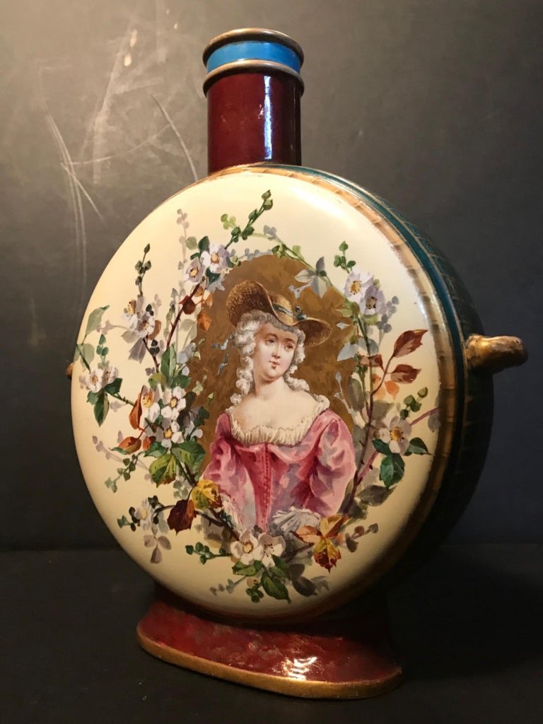 Antique 19th century Royal Vienna Belle époque Porcelain moon flask.  This extraordinary Royal Vienna porcelain moon flask is magnificent decorated with a very fine portrait painting of a classical Belle époque girl. The finely rendered hand