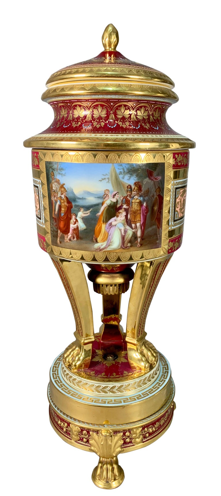 A fine quality 19th century Royal Vienna hand painted porcelain covered Potpourri vase / urn. Constructed in three pieces with a lid and a second central section resting on a stepped plinth base with 3 fluted legs having claw feet and a cylindrical